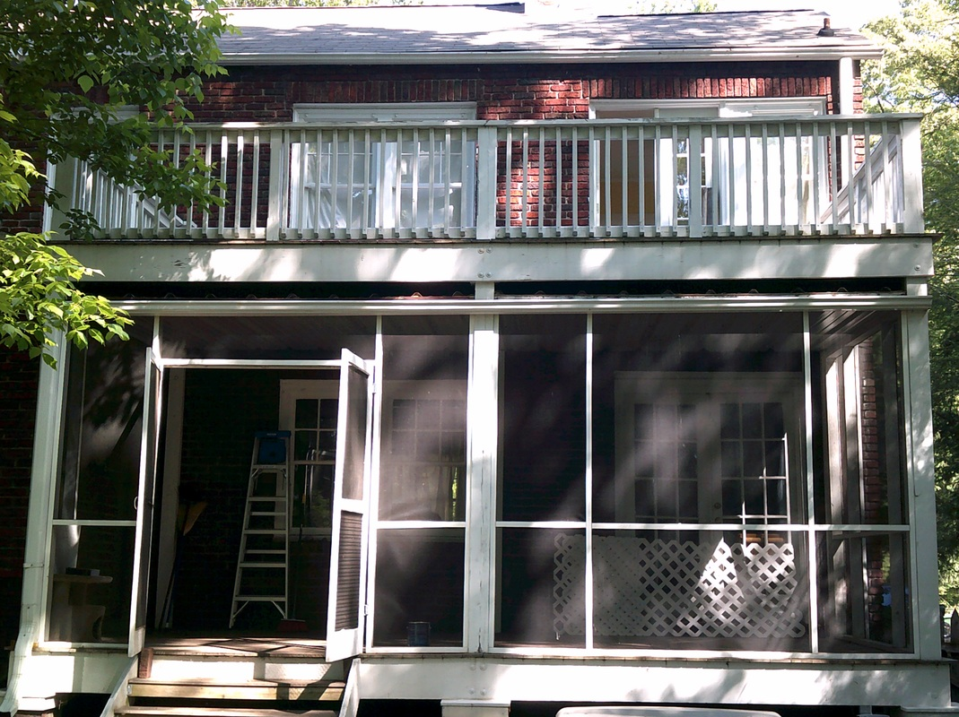 Picture of a screen-in porch from the street, before repainting.