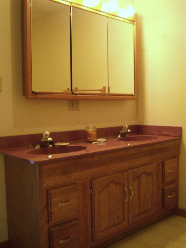 Replace bathroom vanity cabinets, counter and mirror and light fixturesPicture