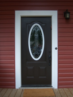 Door before installation of storm door