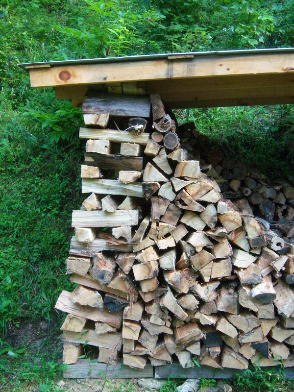 Wood shed to keep firewood dry