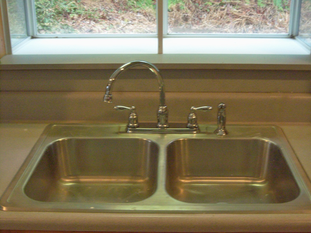 Install new high neck faucet for easy and inexpensive litchen appeal