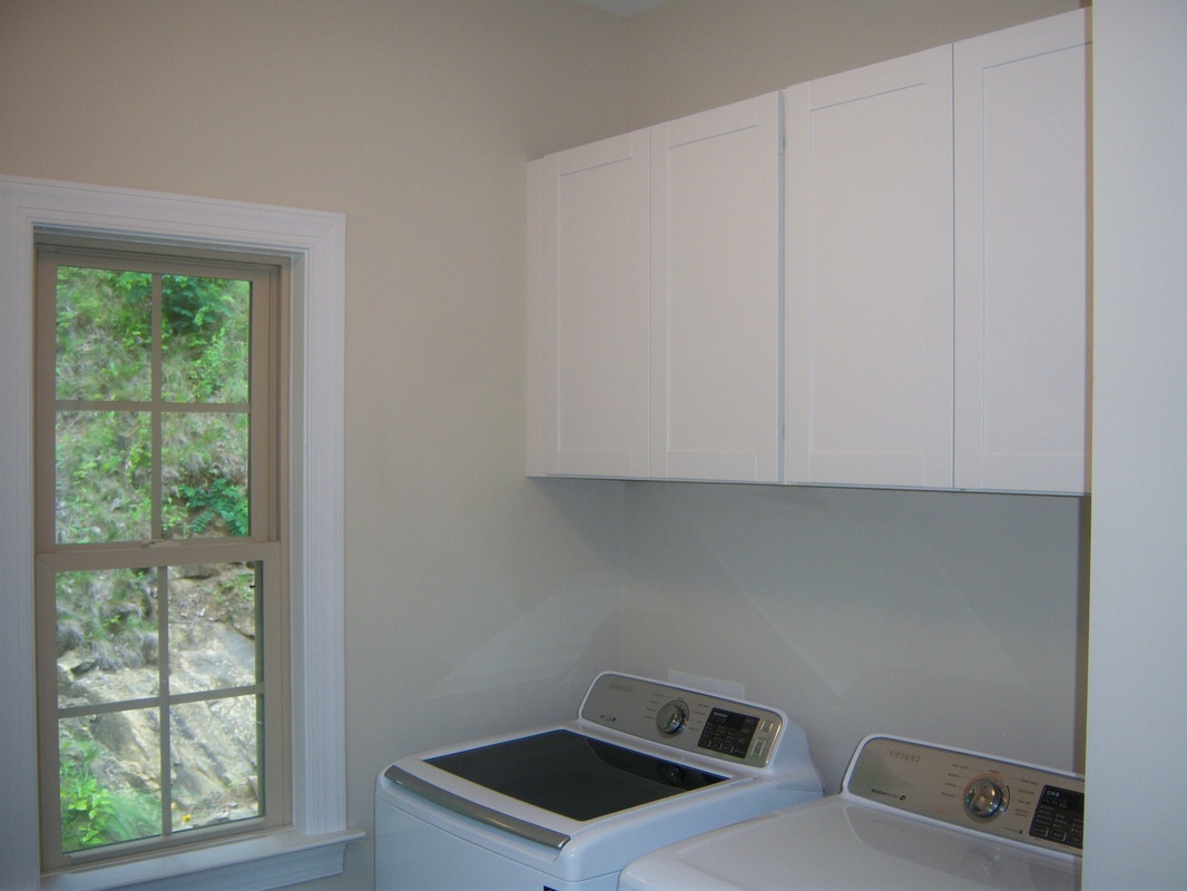 Laundry room cabinets with shelves