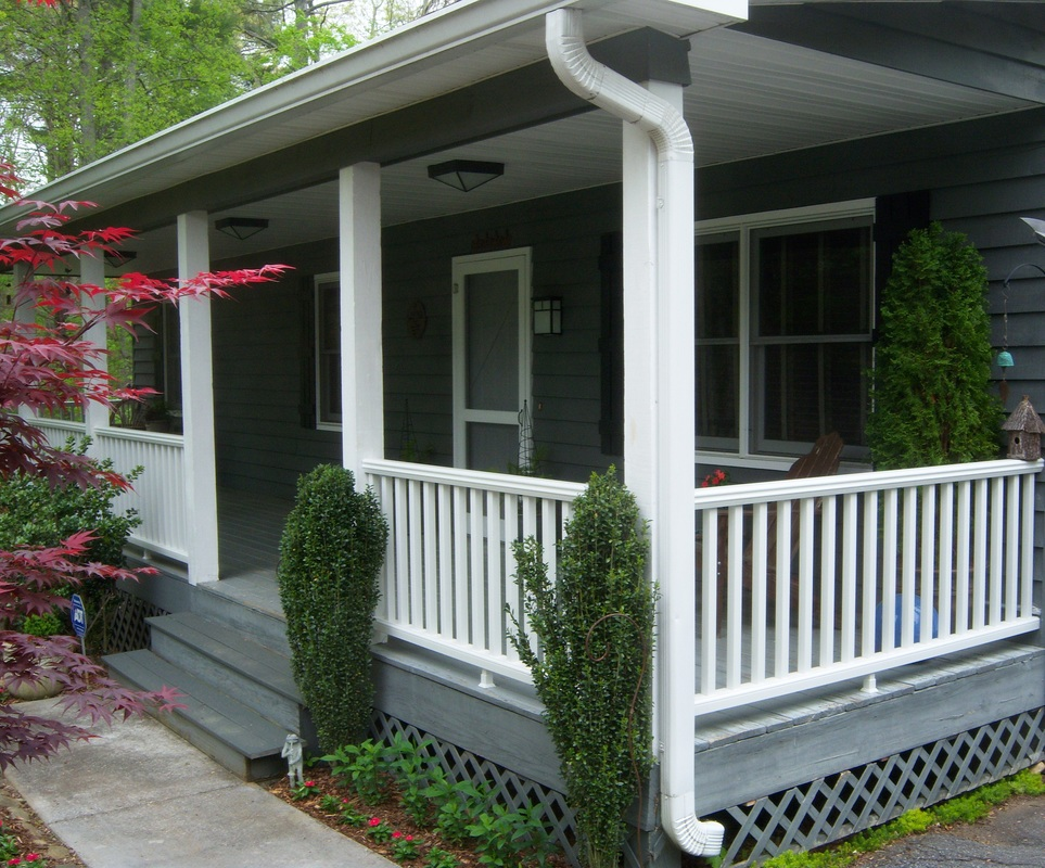 Porch renovation with new railing, shutters and light fixturesPicture